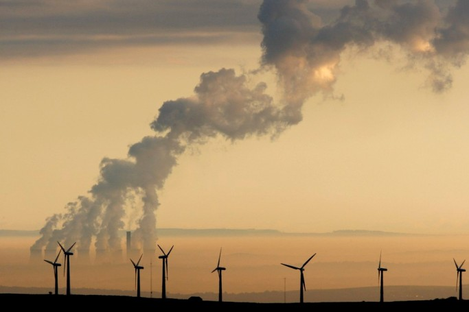 Steam rises from a power station behind the Royd Moor Wind Farm in Penistone near Sheffield, northern England, in this October 19, 2007 file photo. The combination of recession and efforts to jump-start economies can be an investment headache. In recessions, vices like tobacco and alcohol win ground among those daring enough to buy shares. But with Barack Obama stepping in as U.S. President on a pledge to invest in clean energy, growth plays in worthier sectors may also reward. To match feature INVESTMENT-STRATEGIES/ REUTERS/Phil Noble/Files (BRITAIN) - RTR22C4W